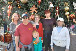 Our family posing in front of the Christmas tree at Main Street