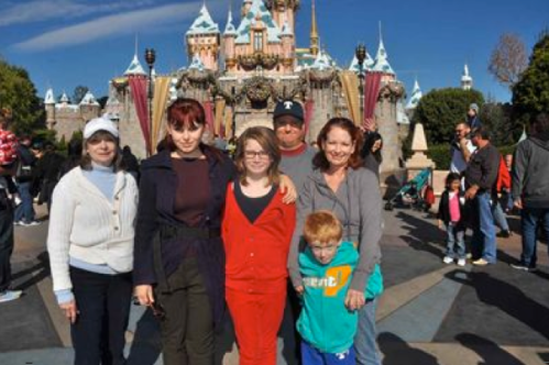 Our family in front of Sleeping Beauty's Castle